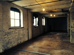 Tall ceilings and arched windows are some of the architectural elements in the Halligan building.